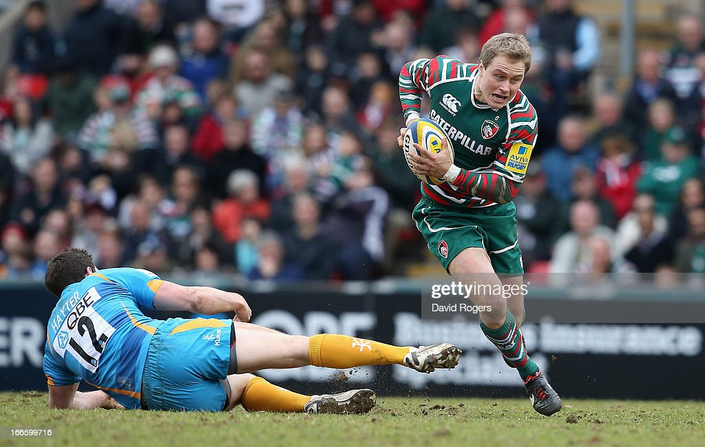 <a gi-track='captionPersonalityLinkClicked' href=/galleries/search?phrase=Mathew+Tait&family=editorial&specificpeople=214771 ng-click='$event.stopPropagation()'>Mathew Tait</a> of Leicester moves past Charlie Hayter during the Aviva Premiership match between Leicester Tigers and London Wasps at Welford Road on April 14, 2013 in Leicester, England.