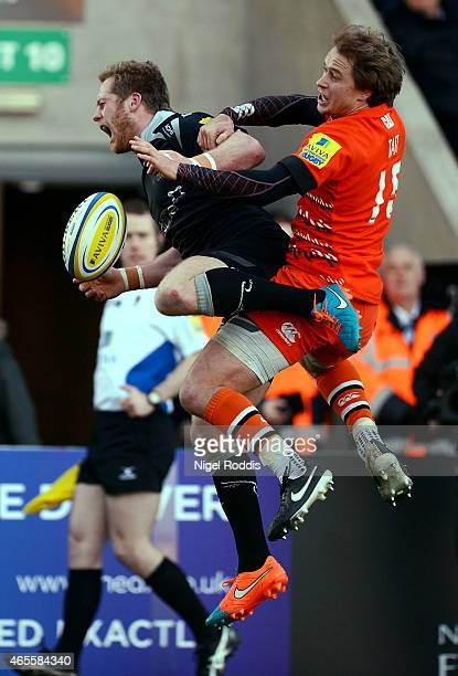 Mathew Tait of Leicester Tigers challenges Alex Tait of Newcastle Falcons during the Aviva Premiership match between Newcastle Falcons and Leicester...