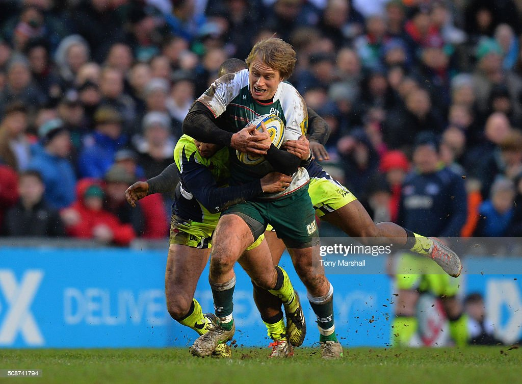 <a gi-track='captionPersonalityLinkClicked' href=/galleries/search?phrase=Mathew+Tait&family=editorial&specificpeople=214771 ng-click='$event.stopPropagation()'>Mathew Tait</a> of Leicester Tigers is tackled by <a gi-track='captionPersonalityLinkClicked' href=/galleries/search?phrase=Danny+Cipriani&family=editorial&specificpeople=688774 ng-click='$event.stopPropagation()'>Danny Cipriani</a> and Neville Edwards of Sale Sharks during the Aviva Premiership match between Leicester Tigers and Sale Sharks at Welford Road on February 6, 2016 in Leicester, England.