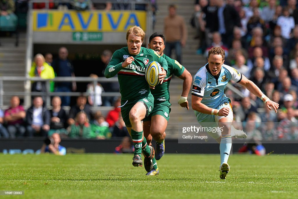 Mathew Tait of Leicester Tigers makes a break during the Aviva Premiership Final between Leicester Tigers and Northampton Saints at Twickenham Stadium on May 25, 2013 in London, England.