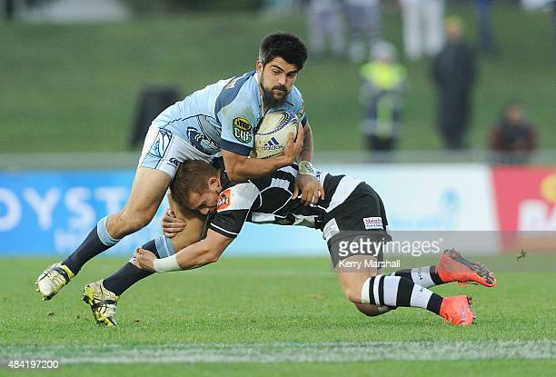 Mathew Wright of Northland is tackled by Ihaia West of Hawkes Bay during the round one ITM Cup match between Hawke's Bay and Northland on August 16...