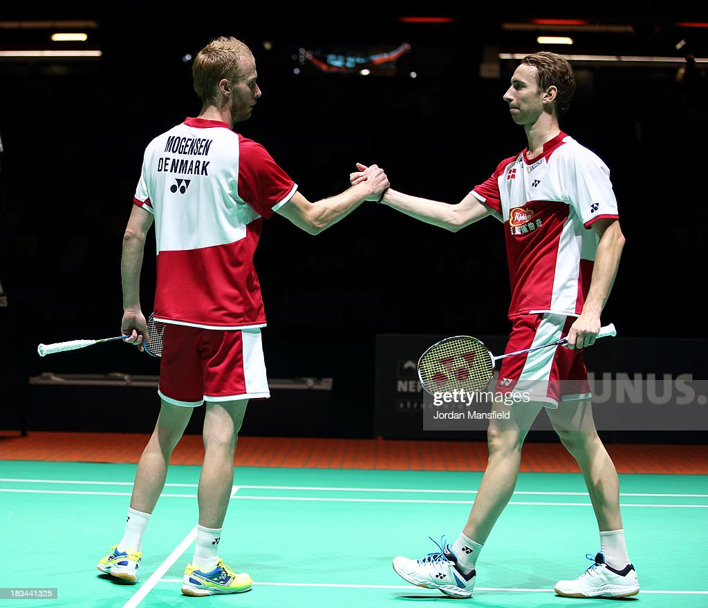 Mathian Boe (R) and Carsten Mogensen (L) of Denmark congratulate each other after winning the Men's Doubles Final against Berry Angriawan and Ricky Karanda Suwardi of Indonesia during Day 6 of the London Badminton Grand Prix at The Copper Box on October 6, 2013 in London, England.