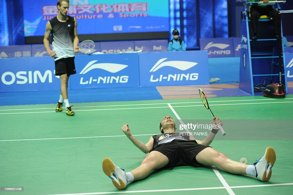 Mathias Boe (R) and Carsten Mogensen (L) of Denmark celebrate after beating Ko Sung Hyan and Lee Yong Doe of South Korea in the men's doubles final at the China Open badminton tournament in Shanghai on November 18, 2012. AFP PHOTO/Peter PARKS