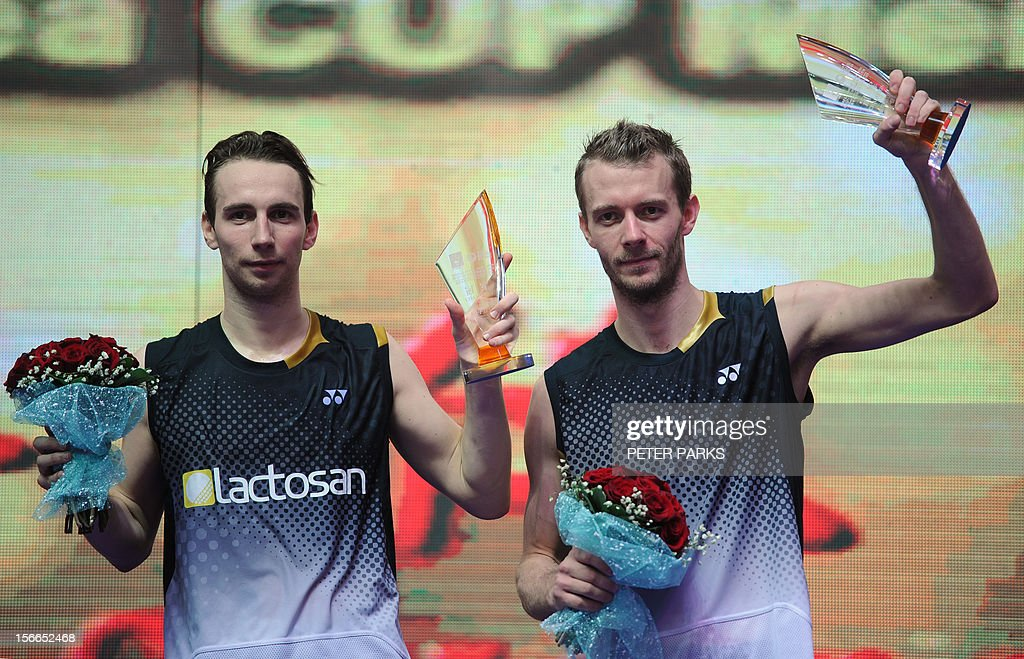 Mathias Boe (L) and Carsten Mogensen (R) of Denmark celebrate after beating Ko Sung Hyan and Lee Yong Doe of South Korea in the men's doubles final at the China Open badminton tournament in Shanghai on November 18, 2012. AFP PHOTO/Peter PARKS