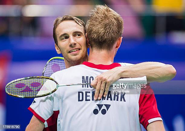 Mathias Boe and Carsten Mogensen of Denmark celebrate after winning their men's doubles semifinal match against Kim Kj Jung and Kim Sa Rang of South...