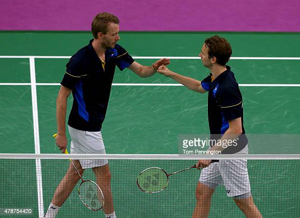 Mathias Boe and Carsten Mogensen of Denmark celebrate during the Men's Badminton Doubles final against Vladimir Ivanov and Ivan Sozonov of Russia on...