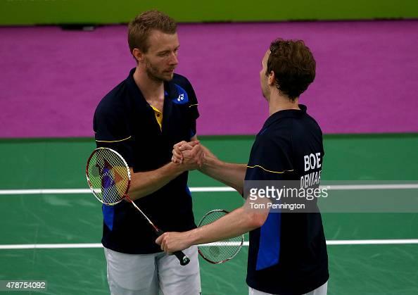 Mathias Boe and Carsten Mogensen of Denmark celebrate winning gold in the Men's Badminton Doubles final against Vladimir Ivanov and Ivan Sozonov of...