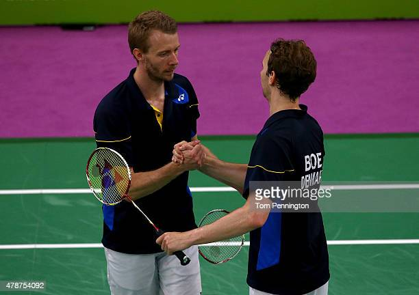 Mathias Boe and Carsten Mogensen of Denmark celebrate winning gold in the Men's Badminton Doubles final against Vladimir Ivanov and Ivan Sozonov of...