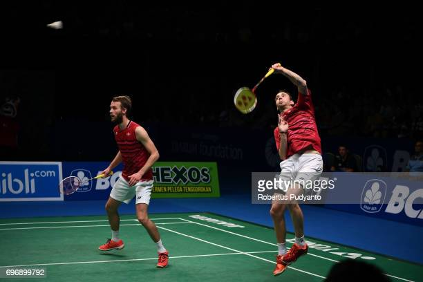 Mathias Boe and Carsten Mogensen of Denmark compete against Fajar Alfian and Muhammad Rian Ardianto of Indonesia during Mens Double Semifinal match...