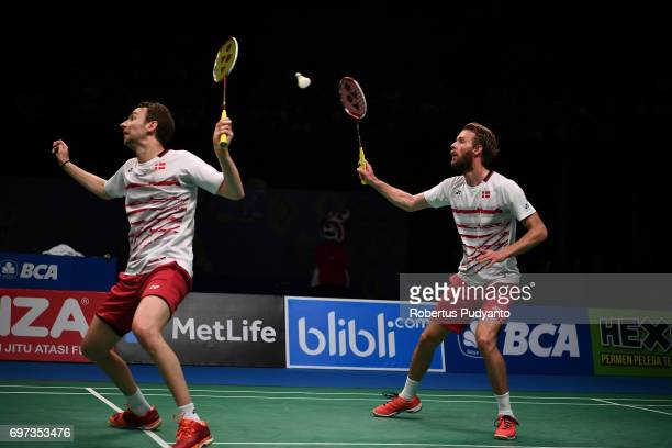 Mathias Boe and Carsten Mogensen of Denmark compete against Li Junhui and Liu Yuchen of China during Men's Double Final match of the BCA Indonesia...