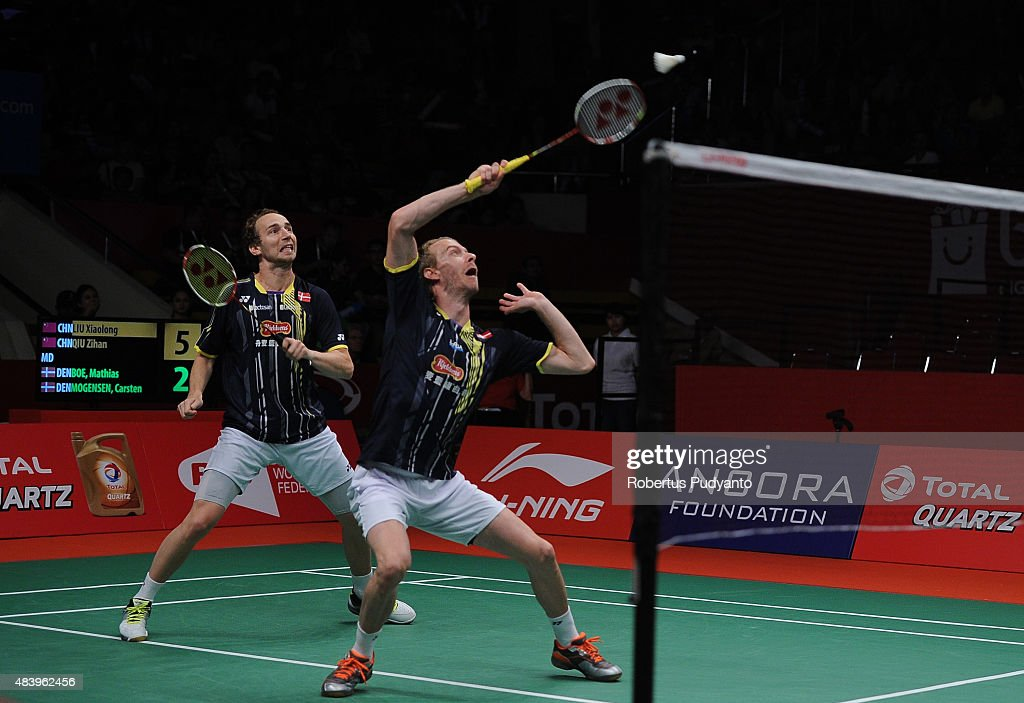 <a gi-track='captionPersonalityLinkClicked' href=/galleries/search?phrase=Mathias+Boe&family=editorial&specificpeople=651077 ng-click='$event.stopPropagation()'>Mathias Boe</a> and <a gi-track='captionPersonalityLinkClicked' href=/galleries/search?phrase=Carsten+Mogensen&family=editorial&specificpeople=651076 ng-click='$event.stopPropagation()'>Carsten Mogensen</a> of Denmark compete against Liu Xiaolong and Qiu Zihan of China in the quarter final match of the 2015 Total BWF World Championship at Istora Senayan on August 14, 2015 in Jakarta, Indonesia.