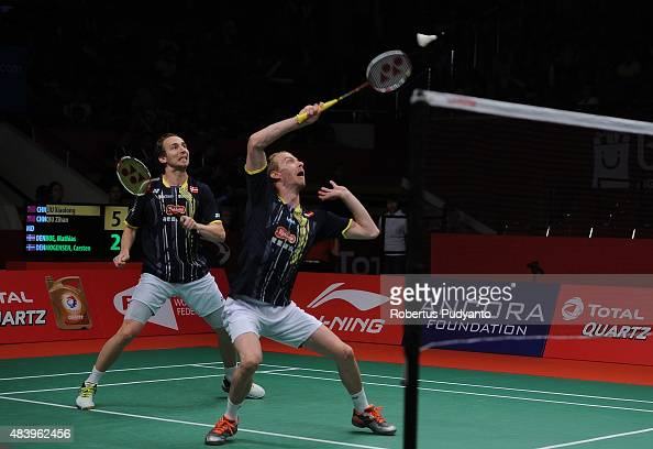 Mathias Boe and Carsten Mogensen of Denmark compete against Liu Xiaolong and Qiu Zihan of China in the quarter final match of the 2015 Total BWF...