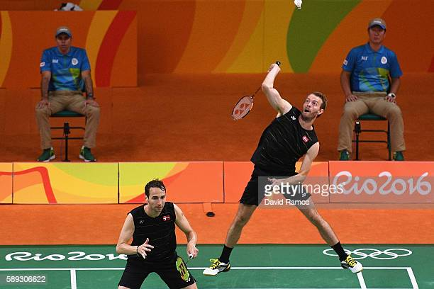 Mathias Boe and Carsten Mogensen of Denmark compete against Sa Rang Kim and Jung Kim Gi of Republic of Korea during the Men's Doubless Play Stage...