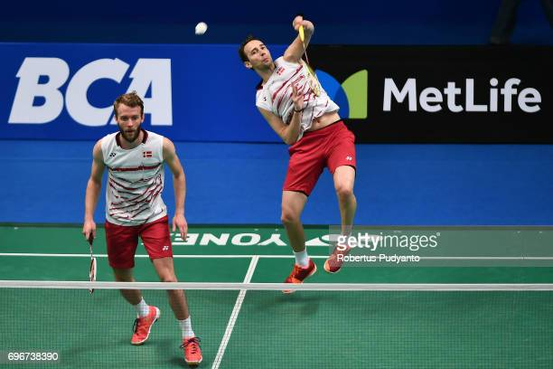 Mathias Boe and Carsten Mogensen of Denmark compete against Vladimir Ivanov and Ivan Sozonov of Russia during Mens Double Quarterfinal match of the...