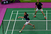 Mathias Boe and Carsten Mogensen of Denmark compete during the Men's Badminton Doubles final against Vladimir Ivanov and Ivan Sozonov of Russia on...