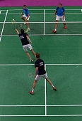 Mathias Boe and Carsten Mogensen of Denmark compete in the Men's Badminton Doubles final against Vladimir Ivanov and Ivan Sozonov of Russia on day...