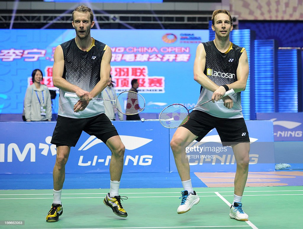 Mathias Boe R and Carsten Mogensen L of Denmark dance Gangnam