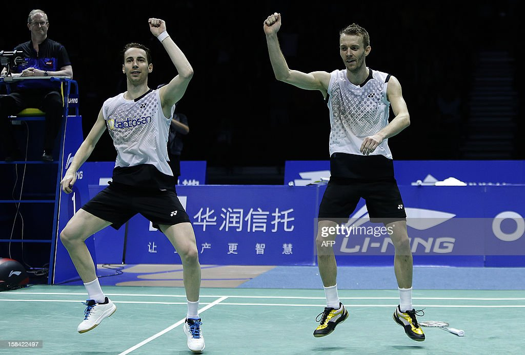 Mathias Boe (L) and Carsten Mogensen of Denmark dance the Gangnan Style as they celebrate after beating Hiroyuki Endo and Kenichi Hayakawa of Japan in the men's doubles final match of the 2012 BWF Superseries Finals in Shenzhen, south China's Guangdong province on December 16, 2012. Boe and Mogensen beat Endo and Hayakawa 21-17, 21-19 for the title. AFP PHOTO