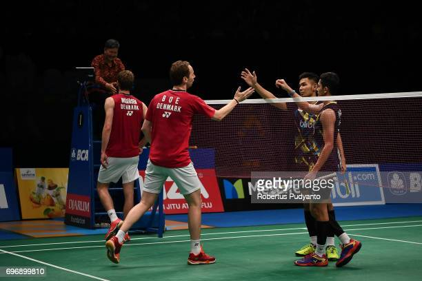 Mathias Boe and Carsten Mogensen of Denmark greet Fajar Alfian and Muhammad Rian Ardianto of Indonesia during Mens Double Semifinal match of the BCA...