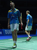 Mathias Boe and Carsten Mogensen of Denmark look dejected and frustrated after they lose a point against Lee Yong Dae and Yoo Yeon Seong of Korea in...