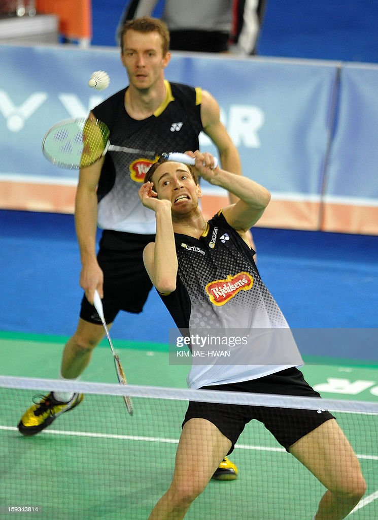 Mathias Boe (R) and Carsten Mogensen of Denmark play a shot during their men's doubles badminton match against Hong Wei and Shen Ye of China during the semi-finals of the Korea Open at Seoul on January 12, 2013. Mathias Boe and Carsten Mogensen won the match 19-21, 21-10, 21-18.