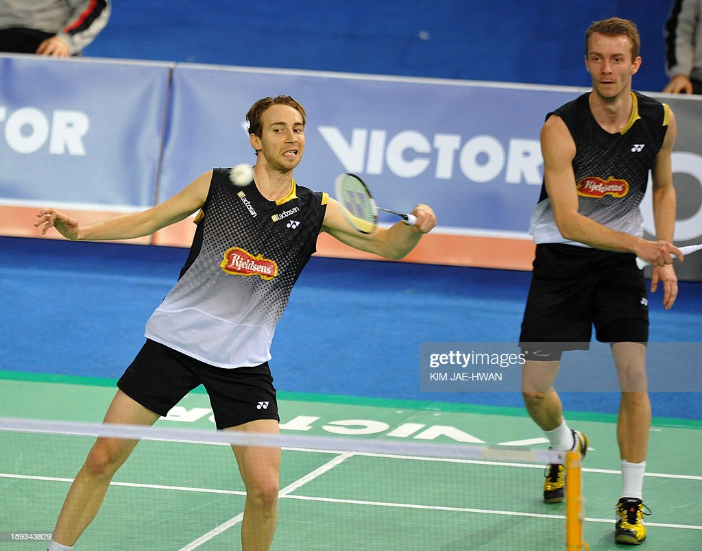 Mathias Boe (L) and Carsten Mogensen of Denmark play a shot during their men's doubles badminton match against Hong Wei and Shen Ye of China during the semi-finals of the Korea Open at Seoul on January 12, 2013. Mathias Boe and Carsten Mogensen won the match 19-21, 21-10, 21-18. AFP PHOTO / KIM JAE-HWAN