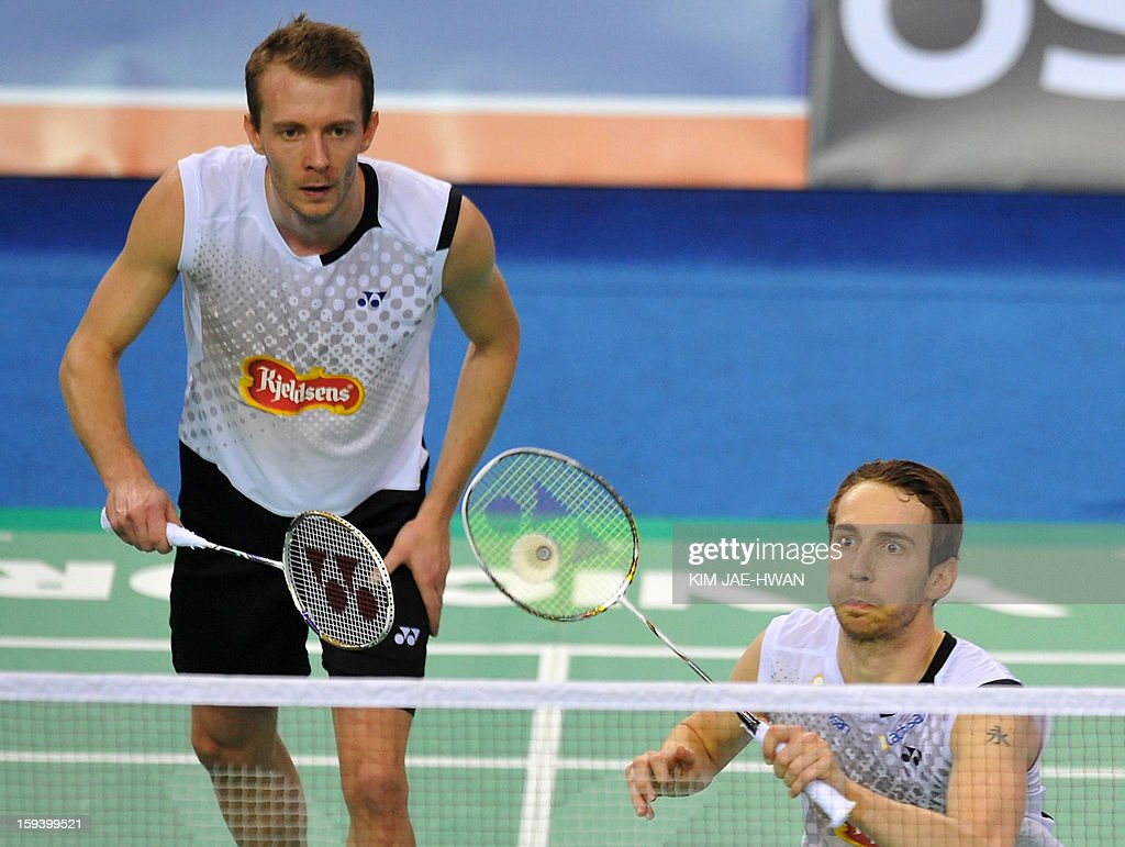 Mathias Boe (R) and Carsten Mogensen (L) of Denmark play a shot in their men's doubles badminton match against Lee Yong-Dae and Ko Sung-Hyun of South Korea during the finals of the Korea Open at Seoul on January 13, 2013. Lee Yong-Dae and Ko Sung-Hyun won the match 19-21, 21-13, 21-10. AFP PHOTO / KIM JAE-HWAN