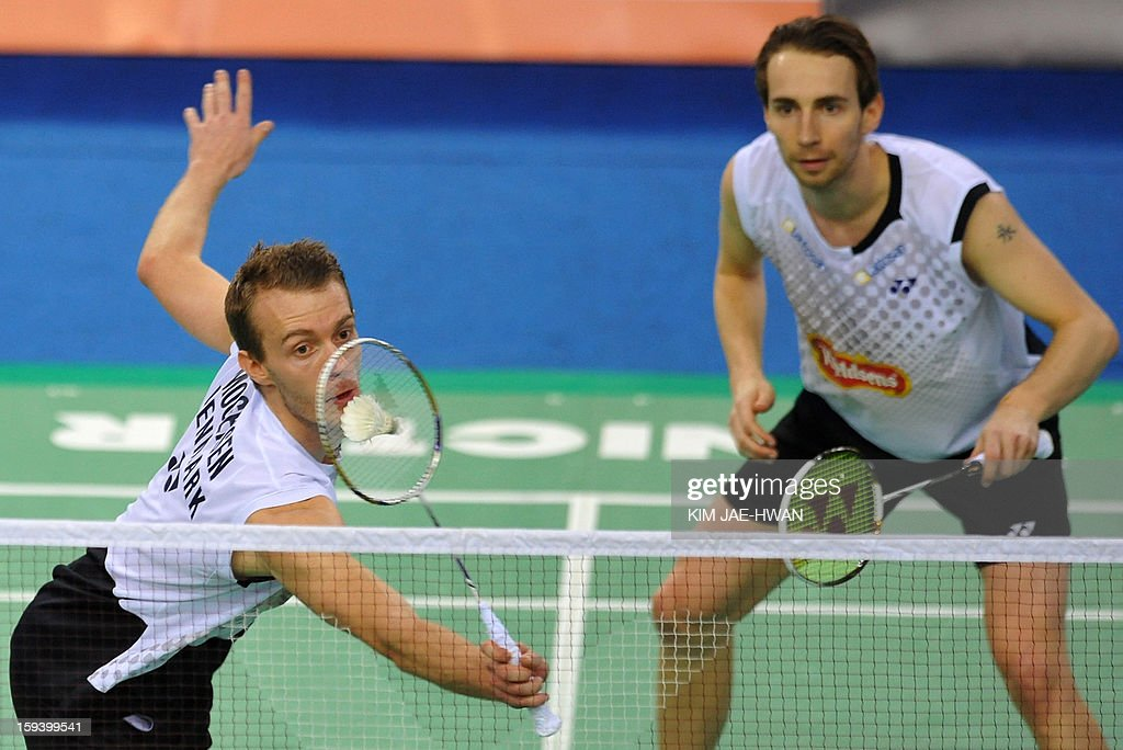 Mathias Boe (R) and Carsten Mogensen (L) of Denmark play a shot in their men's doubles badminton match against Lee Yong-Dae and Ko Sung-Hyun of South Korea during the finals of the Korea Open at Seoul on January 13, 2013. Lee Yong-Dae and Ko Sung-Hyun won the match 19-21, 21-13, 21-10.