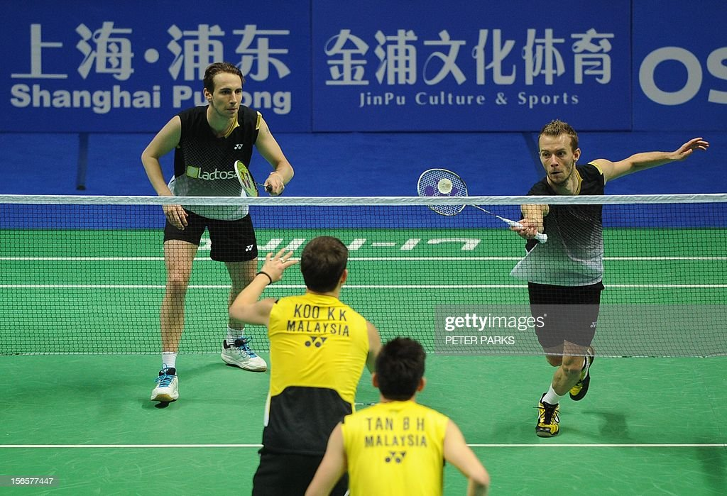 Mathias Boe (Top-L) and Carsten Mogensen (Top-R) of Denmark play Kien Keet Koo (Bottom-L) and Boon Heong Tan (Bottom-R) of Malaysia in their men's doubles semi-final match at the China Open badminton tournament in Shanghai on November 17, 2012. AFP PHOTO/Peter PARKS