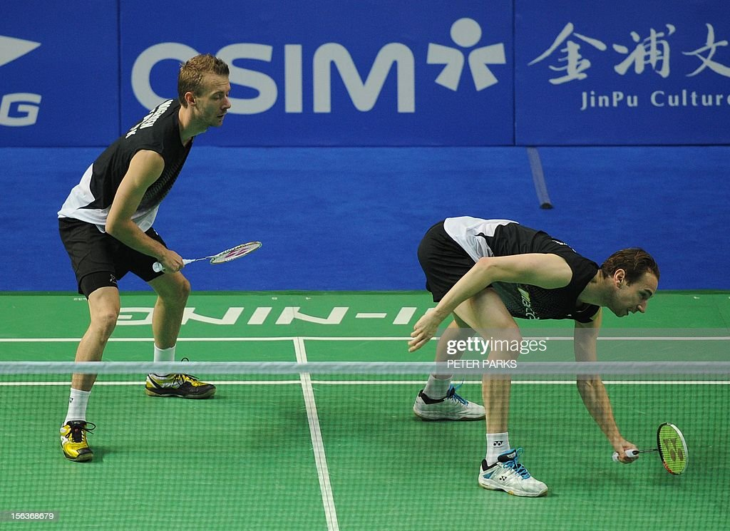 Mathias Boe (R) and Carsten Mogensen of Denmark (L) play Vladimir Ivanov and Ivan Sozonov during their men's doubles first round match at the China Open badminton tournament in Shanghai on November 14, 2012. AFP PHOTO/Peter PARKS