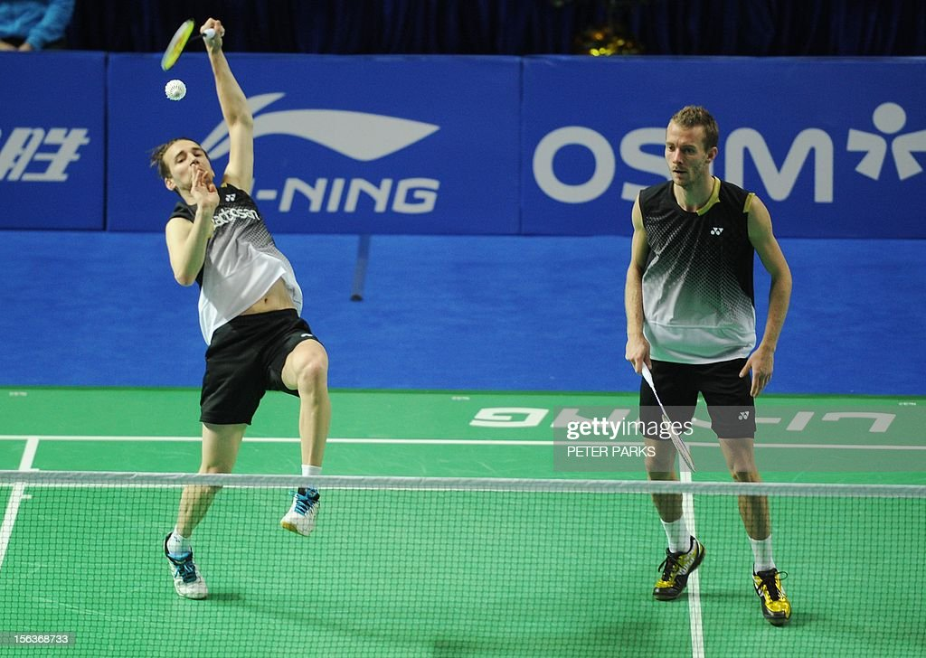 Mathias Boe (L) and Carsten Mogensen (R) of Denmark play Vladimir Ivanov and Ivan Sozonov during their men's doubles first round match at the China Open badminton tournament in Shanghai on November 14, 2012. AFP PHOTO/Peter PARKS