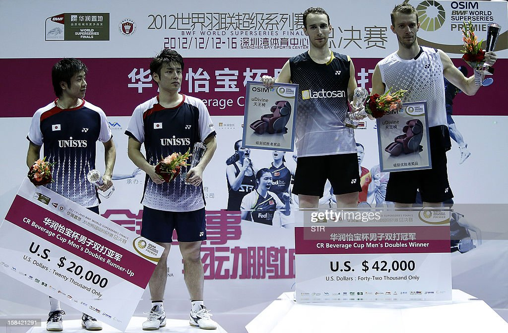 Mathias Boe and Carsten Mogensen (R) of Denmark pose with Hiroyuki Endo and Kenichi Hayakawa of Japan during the award ceremony for the men's doubles final match of the 2012 BWF Superseries Finals in Shenzhen, south China's Guangdong province on December 16, 2012. Boe and Mogensen beat Endo and Hayakawa 21-17, 21-19 for the title.