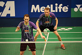 Mathias Boe and Carsten Mogensen of Denmark return a shot against Andrei Adistia and Hendra Aprida Gunawan of Indonesia during the 2015 BCA Indonesia...