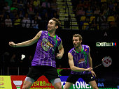Mathias Boe and Carsten Mogensen of Denmark return a shot during the match between Mathias Boe and Carsten Mogensen of Denmark and Mohammad Ahsan and...