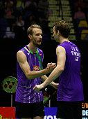 Mathias Boe and Carsten Mogensen of Denmark return reacts after winning the match between Mathias Boe and Carsten Mogensen of Denmark and Mohammad...