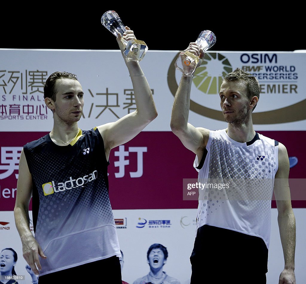 Mathias Boe and Carsten Mogensen (R) of Denmark show off their trophies after beating Hiroyuki Endo and Kenichi Hayakawa of Japan in the men's doubles final match of the 2012 BWF Superseries Finals in Shenzhen, south China's Guangdong province on December 16, 2012. Boe and Mogensen beat Endo and Hayakawa 21-17, 21-19 for the title.