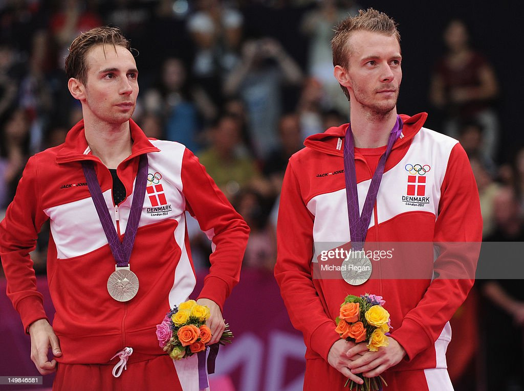 Mathias Boe and Carsten Mogensen of Denmark (R) stand with their Silver medals following the Men's Doubles Badminton Gold Medal match on Day 9 of the London 2012 Olympic Games at Wembley Arena on August 5, 2012 in London, England.