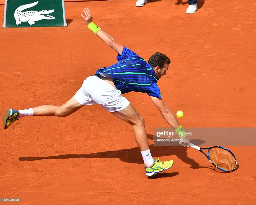 Mathias Bourgue of France in an action during the men's single second round match against Andy Murray of Britain at the French Open tennis tournament at Roland Garros in Paris, France on May 25, 2016.