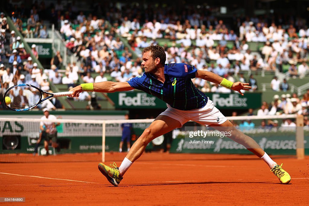 Mathias Bourgue of France plays a backhand during the Men's Singles second round match against Andy Murray of Great Britain on day four of the 2016 French Open at Roland Garros on May 25, 2016 in Paris, France.