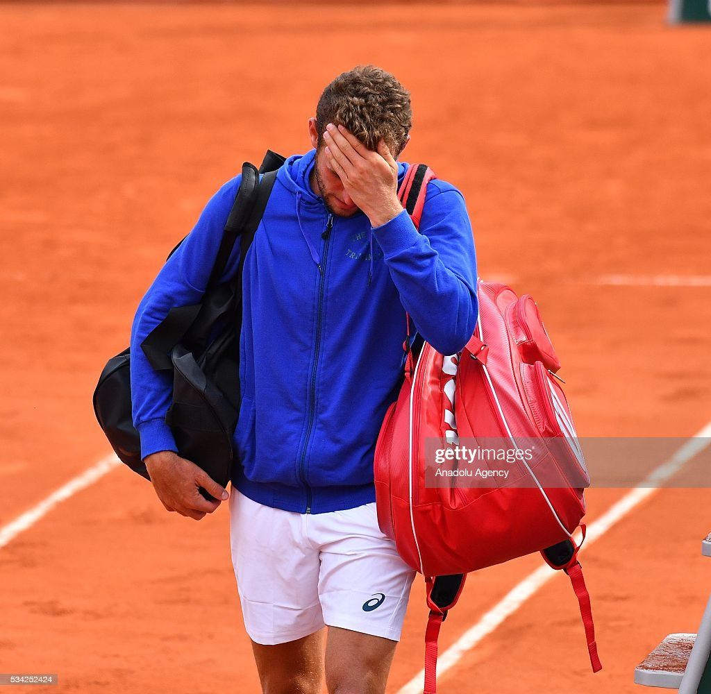 Mathias Bourgue of France reacts after the men's single second round match against Andy Murray of Britain at the French Open tennis tournament at Roland Garros in Paris, France on May 25, 2016.