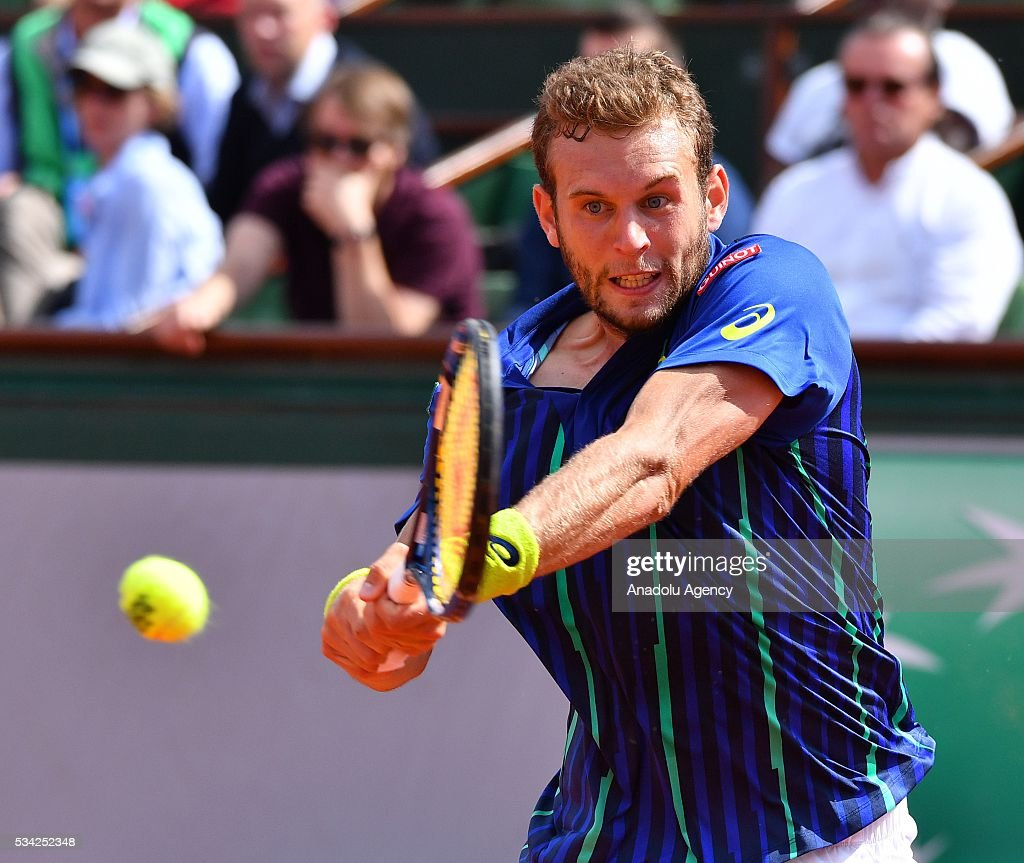 Mathias Bourgue of France returns the ball during the men's single second round match against Andy Murray of Britain at the French Open tennis tournament at Roland Garros in Paris, France on May 25, 2016.