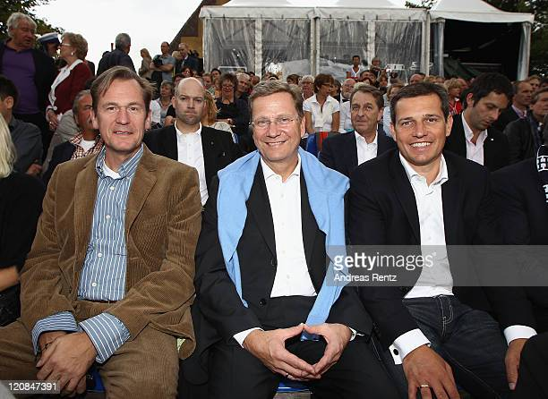 Mathias Doepfner Guido Westerwelle and partner Michael Mronz attend the 'The Magic Flute' premiere by Wolfgang Amadeus Mozart during the...