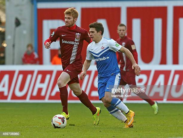 Mathias Fetsch of Dresden battles for the ball with Julian Jakobs of Rostock during the third league match between FC Hansa Rostock and SG Dynamo...