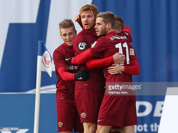 Mathias Fetsch of Dresden jubilates with team mates after scoring the first goal during the third league match between FC Hansa Rostock and SG Dynamo...