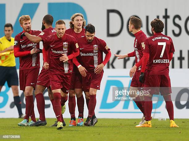 Mathias Fetsch of Dresden jubilates with team mates after scoring the fourth goal during the third league match between FC Hansa Rostock and SG...