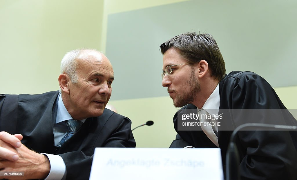Mathias Grasel and Hermann Borchert lawyers of defendant Beate Zschaepe talk prior to the continuation of the trial at a courtroom in Munich southern...