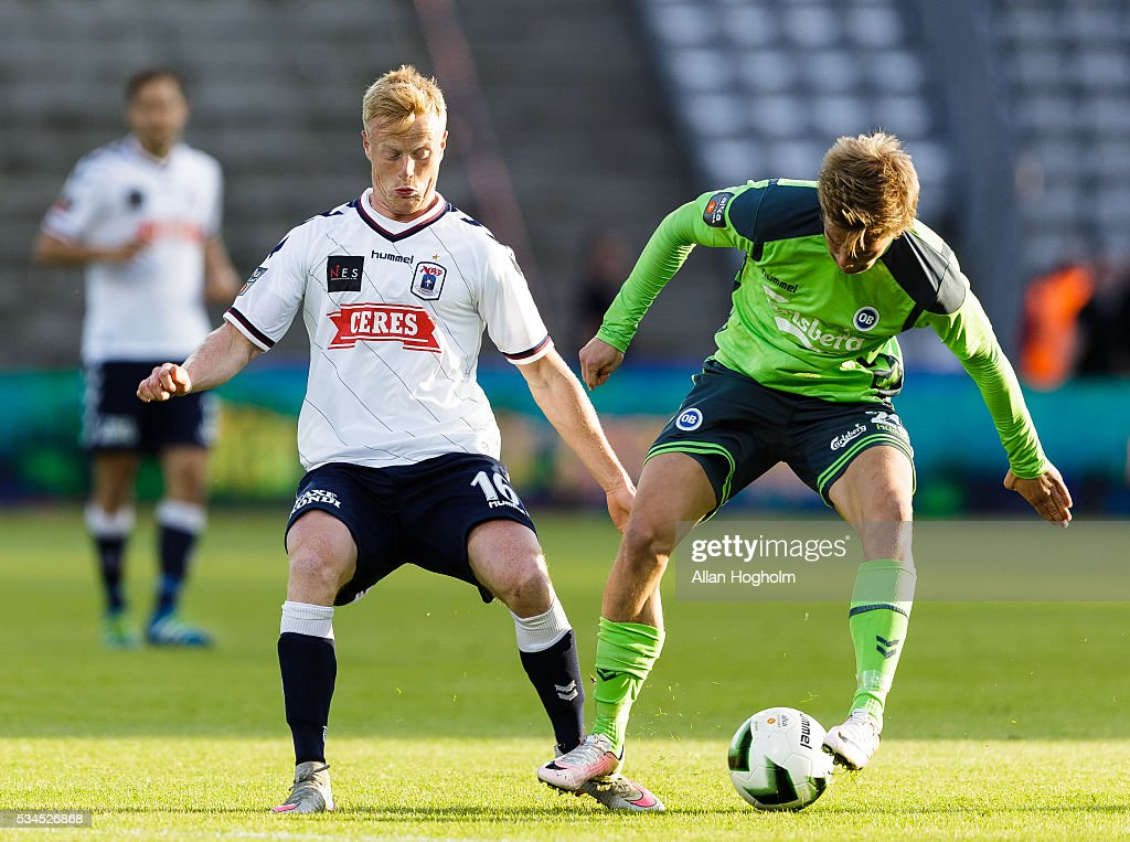 Mathias Greve of OB and Jens Jonsson of AGF compete for the ball during the Danish Alka Superliga match between AGF Aarhus and OB Odense at Ceres Park on May 26, 2016 in Aarhus, Denmark.