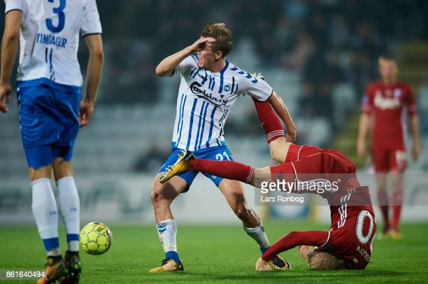 Mathias Greve of OB Odense and Nicolai Boilesen of FC Copenhagen compete for the ball during the Danish Alka Superliga match between OB Odense and FC...