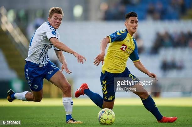 Mathias Greve of OB Odense and Svenn Crone of Brondby IF compete for the ball during the Danish Alka Superliga match between OB Odense and Brondby IF...