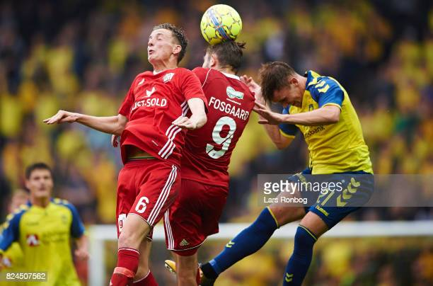 Mathias Hebo Rasmussen of Lyngby BK Lasse Fosgaard of Lyngby BK and Lasse Vigen Christensen of Brondby IF compete for the ball during the Danish Alka...